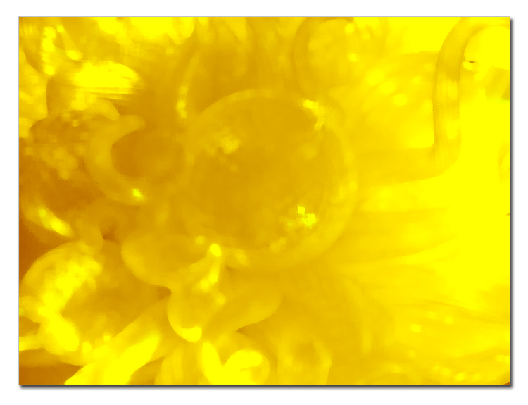 Shot of yellow glass blurred and modified for use as background texture.